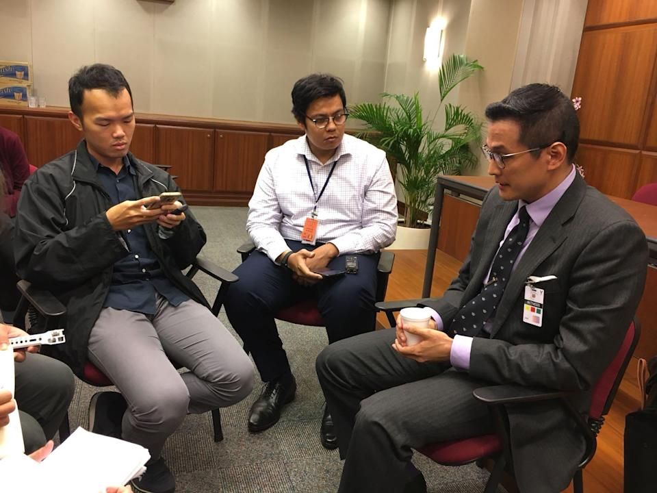 Historian Thum Ping Tjin (right) speaking to reporters after attending a hearing headed by the Select Committee on Deliberate Online Falsehoods on 29 March 2018. Photo: Nicholas Yong/Yahoo News Singapore