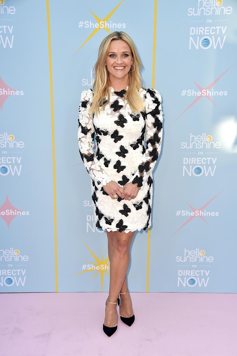 <p>Reese works knee-length dresses like no other. We're big fans of this monochrome, butterfly-print Monique Lhuillier number. <em>[Photo: Getty]</em> </p>
