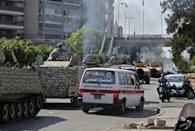 An armoured column of Lebanese troops deploys to Tayouneh, in the mainly Shiite southern suburbs of Beirut, after deadly violence erupts at a protest demanding the replacement of the lead investigator into last year's monster port blast (AFP/JOSEPH EID)