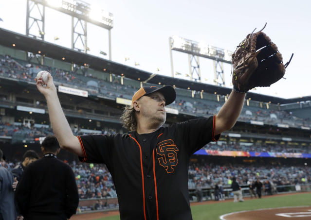 Metallica's Lars Ulrich warms up before throwing the ceremonial first pitch before a baseball game between the San Francisco Giants and the Washington Nationals Monday, April 23, 2018, in San Francisco. (AP Photo/Marcio Jose Sanchez)