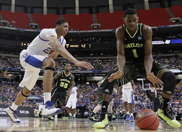Kentucky's Anthony Davis (23 vies for a lose ball with Baylor's Perry Jones III (1) during the second half of an NCAA tournament South Regional finals college basketball game Sunday, March 25, 2012, in Atlanta. (AP Photo/John Bazemore)