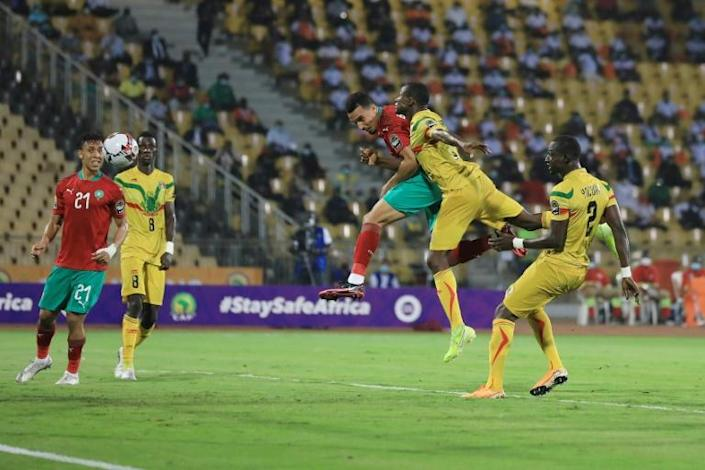 Soufiane Bouftini (C) heads Morocco into the lead in the African Nations Championship final against Mali in Yaounde Sunday.