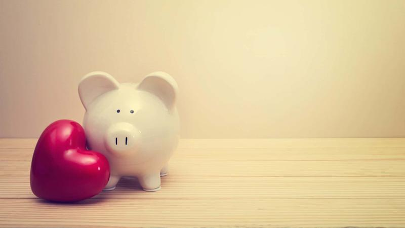 piggy bank and red love heart