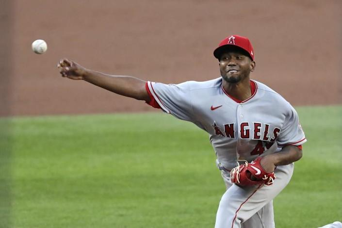"Angels pitcher Julio Teheran did not give up a hard-hit ball during his brief outing against the Seattle Mariners on Wednesday night. <span class=""copyright"">(Elaine Thompson / Associated Press)</span>"