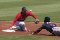 Atlanta Braves' Ronald Acuna Jr., (13) safely slides into second base against Boston Red Sox's Marwin Gonzalez (12) in the first inning during a spring training baseball game on Monday, March 1, 2021, in Fort Myers, Fla. (AP Photo/Brynn Anderson)