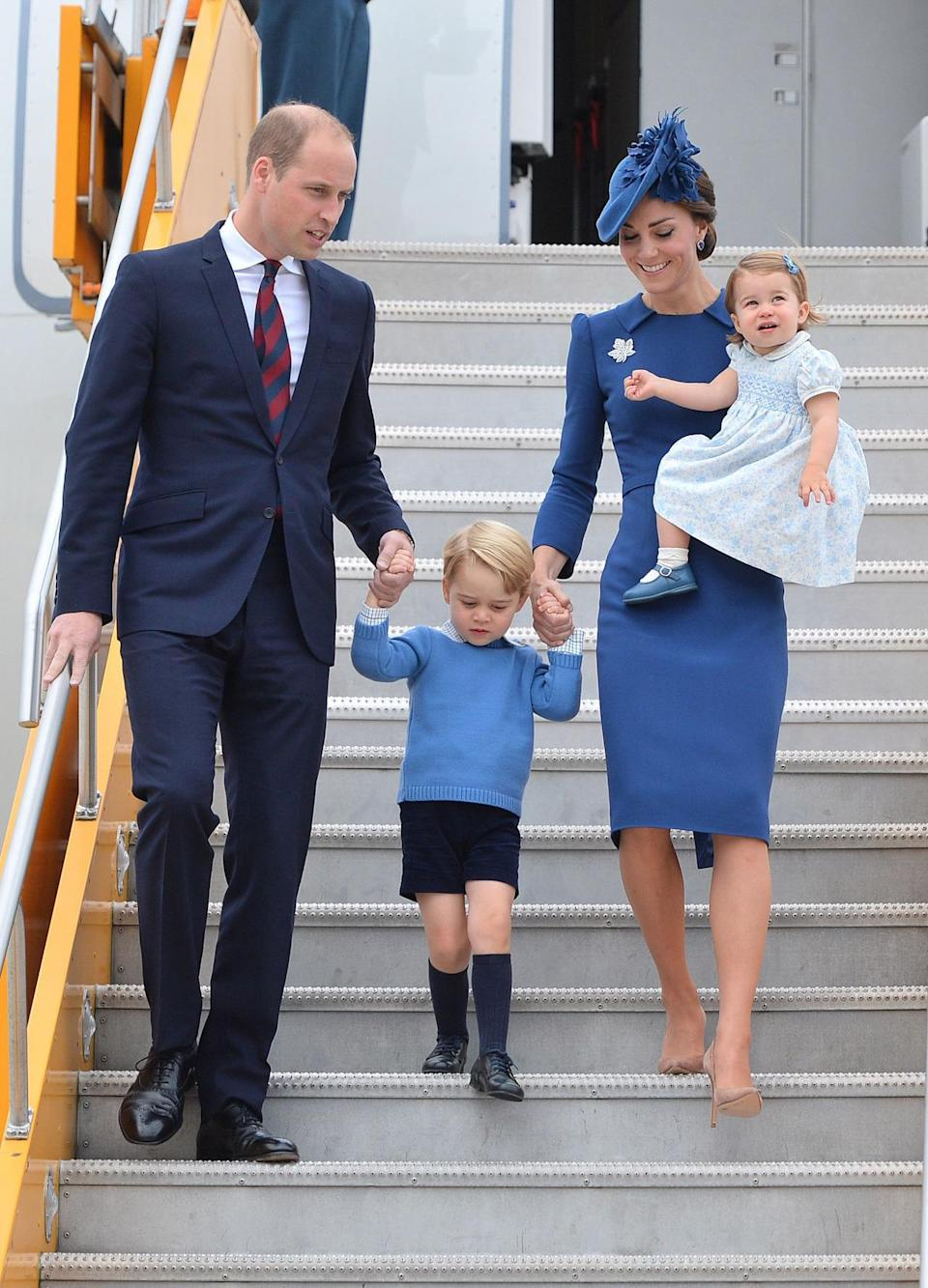 <p>Kate touched down in Canada for the first day of the 2016 royal tour wearing an elegant Jenny Packham dress, a matching blue maple leaf hat and suede Gianvito Rossi pumps. </p><p><i>[Photo: PA] </i></p>