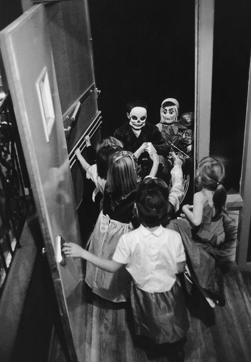 <p><em><strong>In what century did the tradition of trick or treating begin?</strong></em></p><p><strong>Answer: </strong>The American tradition of trick or treating dates back to the 1920s but in Europe, as early as the 16th century people were known to go from door to door on Halloween night asking for food, reciting verses, wearing costumes, and warning of curses if they didn't get a warm welcome. </p>