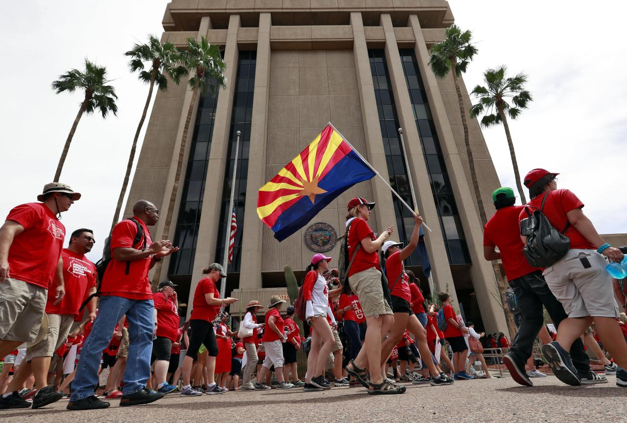<p>Teachers rally outside of Arizona Gov. Doug Ducey's Executive Tower Monday, April 30, 2018, in Phoenix on their third day of walk outs. Teachers in Arizona and Colorado walked out of their classes over low salaries keeping hundreds of thousands of students out of school. It's the latest in a series of strikes across the nation over low teacher pay. (Photo: Matt York/AP) </p>