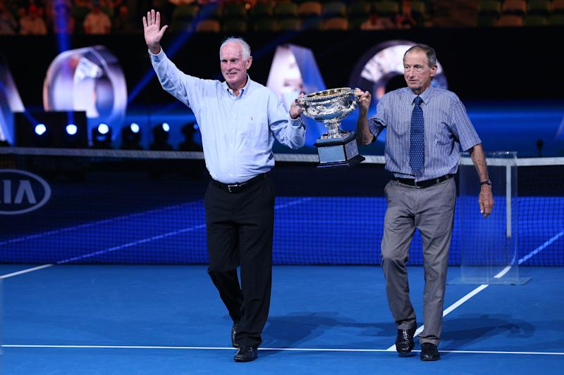 Former champions Bill Bowrey, left and Ashley Cooper, right, present the Norman Brookes Challenge Cup on the 50th and 60th anniversaries, respectively, of their Australian Open wins on Day 14 of the 2018 Australian Open.