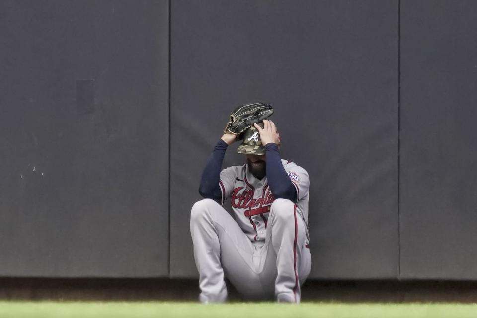 Atlanta Braves' Ender Inciarte reacts after failing to catch a two-run home run hit by Milwaukee Brewers' Avisail Garcia during the fifth inning of a baseball game Sunday, May 16, 2021, in Milwaukee. (AP Photo/Morry Gash)