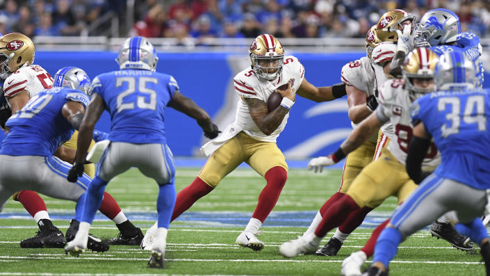 San Francisco 49ers quarterback Trey Lance (5) runs the ball against the Detroit Lions in the second half of an NFL football game in Detroit, Sunday, Sept. 12, 2021. (AP Photo/Lon Horwedel)