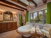 Luxuriate in the claw-foot tub and rock shower. (Credit: Douglas Elliman)