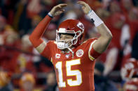 Kansas City Chiefs quarterback Patrick Mahomes celebrates in the final moments of an NFL divisional playoff football game against the Houston Texans, Sunday, Jan. 12, 2020, in Kansas City, Mo. (AP Photo/Charlie Riedel)