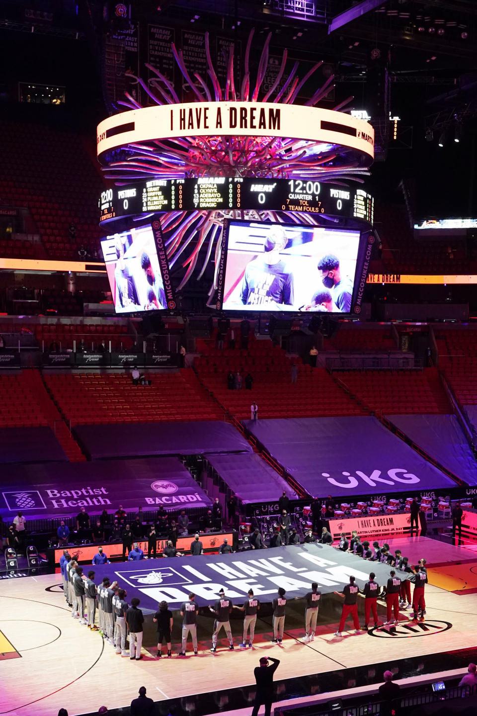 "Miami Heat and Detroit Pistons players hold a ""I Have a Dream"" banner in honor of the Martin Luther King Jr., holiday before an NBA basketball game, Monday, Jan. 18, 2021, in Miami. (AP Photo/Marta Lavandier)"