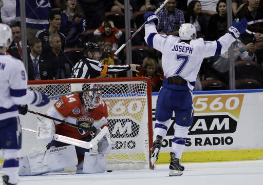 Tampa Bay Lightning right wing Mathieu Joseph (7) celebrates as the puck gets past Florida Panthers goaltender James Reimer (34) on a goal scored by Ryan Callahan during the second period of an NHL hockey game, Sunday, Feb. 10, 2019, in Sunrise, Fla. (AP Photo/Lynne Sladky)