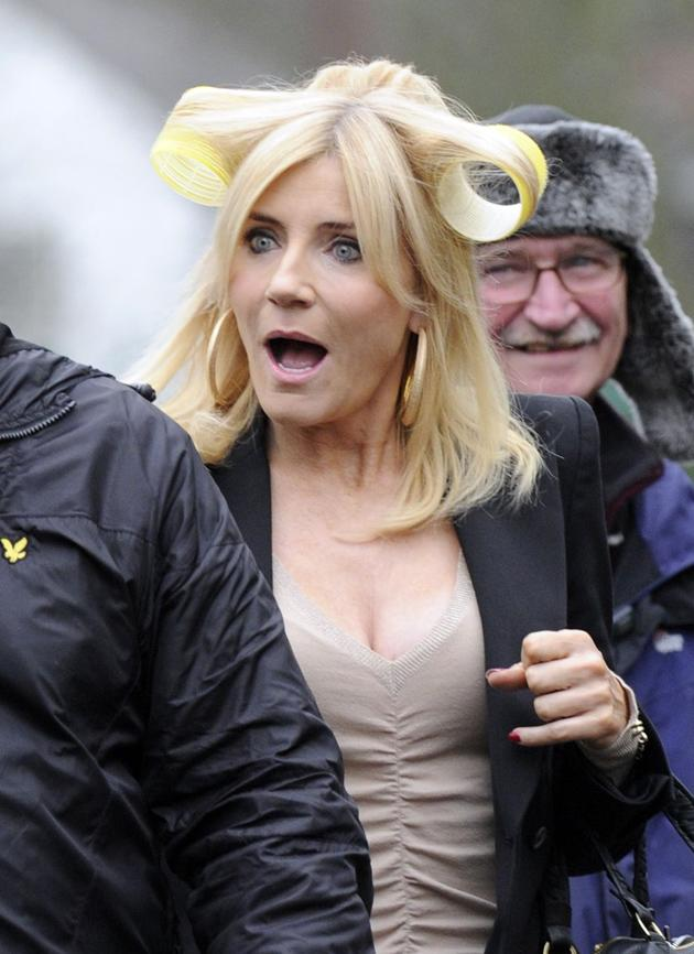 Celebrity photos: Michelle Collins was papped half-way through getting her hair and makeup done on the set of Coronation Street. We quite like the rollers look!