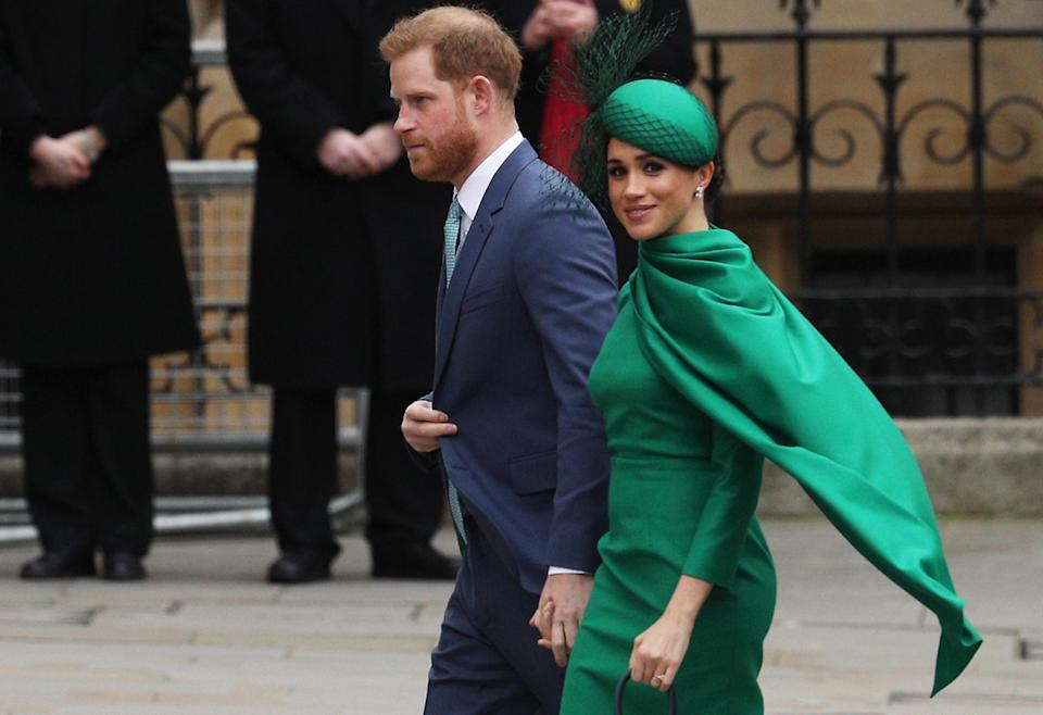 Prince Harry and Meghan Markle are pictured walking while holding hands
