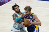 Indiana Pacers' Domantas Sabonis,right, goes to the basket against Charlotte Hornets' Miles Bridges (0) during the first half of an NBA basketball Eastern Conference play-In game Tuesday, May 18, 2021, in Indianapolis. (AP Photo/Darron Cummings)