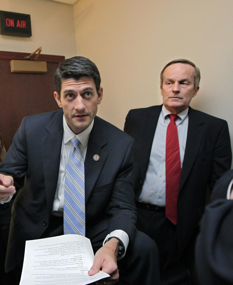 "FILE - In this file photo of Tuesday, April 5, 2011, Missouri Congressman Todd Akin, right, a conservative Republican currently running for the U.S. Senate, listens to House Budget Committee Chairman Paul Ryan, R-Wis., before a news conference on Ryan's budget agenda, on Capitol Hill in Washington. Republican presidential candidate Mitt Romney's campaign on Sunday, Aug. 19, 2012 said Romney and his running mate, Rep. Paul Ryan, disagree with Akin's comments that a woman's body ""has ways"" to prevent pregnancy after rape. Romney spokeswoman Andrea Saul says Romney's administration would not oppose abortion in cases of rape. (AP Photo/J. Scott Applewhite, File)"