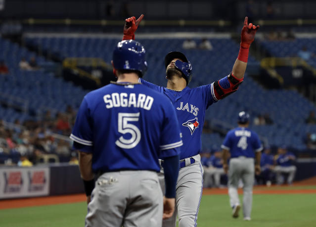 Toronto Blue Jays' Lourdes Gurriel Jr. celebrates his two-run home run with teammate Eric Sogard (5) off Tampa Bay Rays starting pitcher Blake Snell during the first inning of a baseball game Wednesday, May 29, 2019, in St. Petersburg, Fla. (AP Photo/Chris O'Meara)