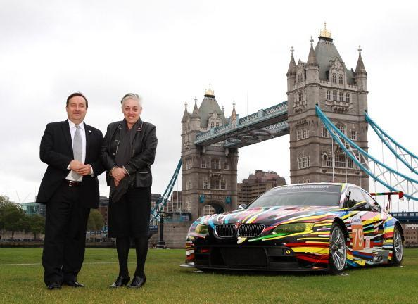LONDON, ENGLAND - JULY 3: Gregor Muir, Executive Director ICA and Ruth Mackenzie, Director London 2012 Festival pose with the transformed M3 GT2 during the launch of BMW Art Car at Potters Field on July 3, 2012 in London, England. (Photo by Jan Kruger/Getty Images for BMW)