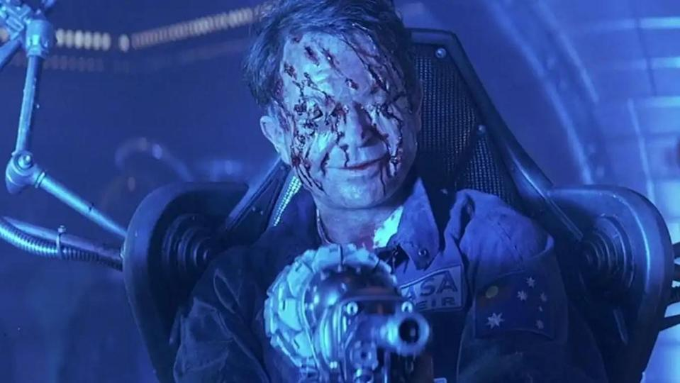 Sam Neill with a horribly scarred face in space horror flick Event Horizon.