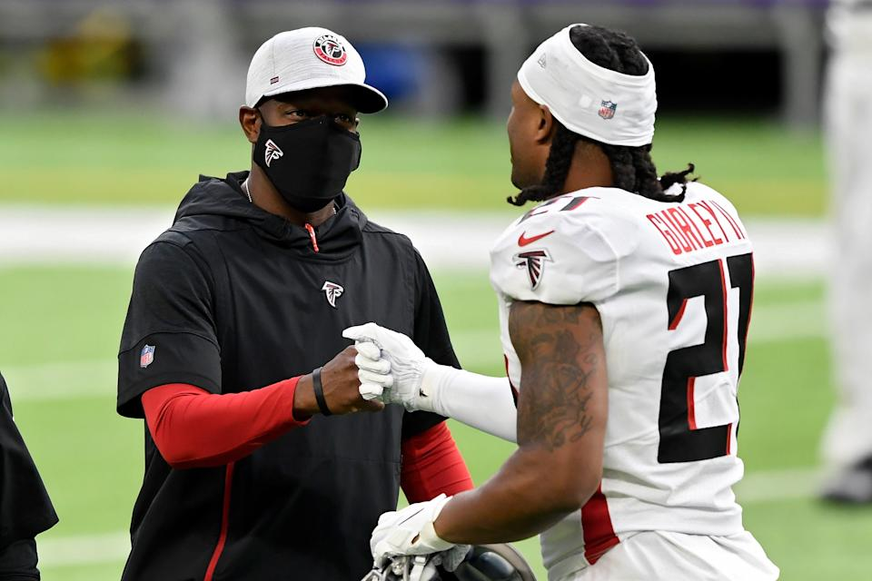 Raheem Morris (left) is the Atlanta Falcons' interim head coach. And if team owner Arthur Blank is to be believed, it's going to take a miracle for him to get the job permanently. (Photo by Hannah Foslien/Getty Images)