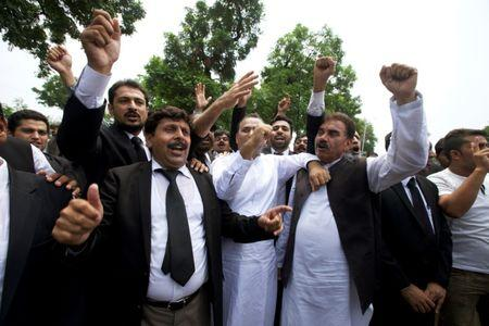 Lawyers chant slogans against Prime Minister Nawaz Sharif outside the Supreme Court building in Islamabad