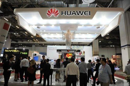 Visitors gather at the Huawei booth during the CommunicAsia telecom expo and conference in Singapore in June 2012. Hackers at an infamous Def Con gathering were shown how to easily slip into computer networks through some routers made by Chinese electronics colossus Huawei Technologies