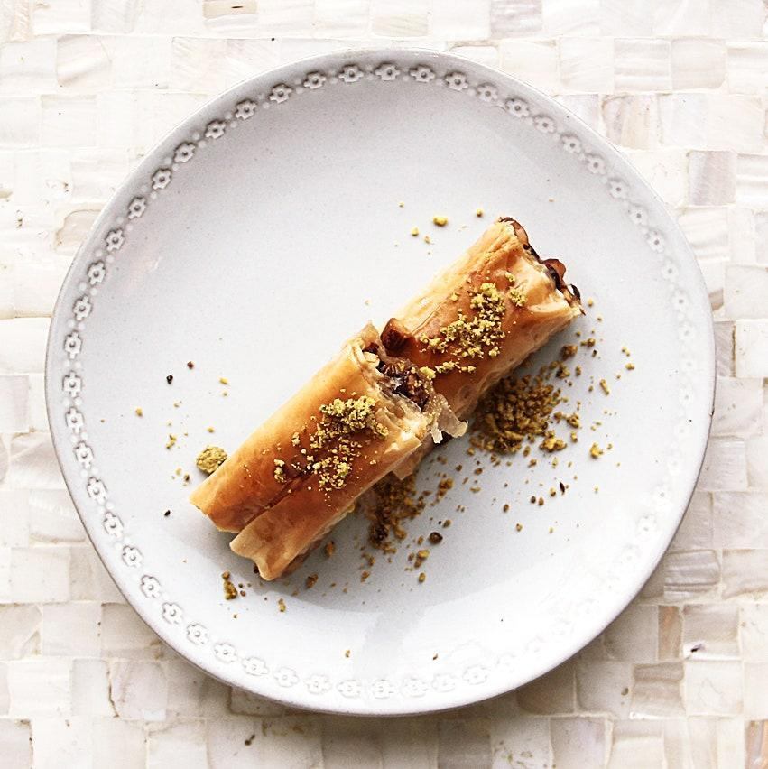 """The East Coast is full of fudge, but where else will you find eight-plus varieties of baklava (all available for contactless, curbside pick-up)? Despite this bakery's name, these Syrian pastries go easy on the sugar, relying on citrus and spices for maximum flavor. Read more about it's founder <a href=""""https://www.bonappetit.com/story/aleppo-sweets-providence?mbid=synd_yahoo_rss"""" rel=""""nofollow noopener"""" target=""""_blank"""" data-ylk=""""slk:Youssef Akhtarini right here"""" class=""""link rapid-noclick-resp""""><strong>Youssef Akhtarini</strong> right here</a>!"""