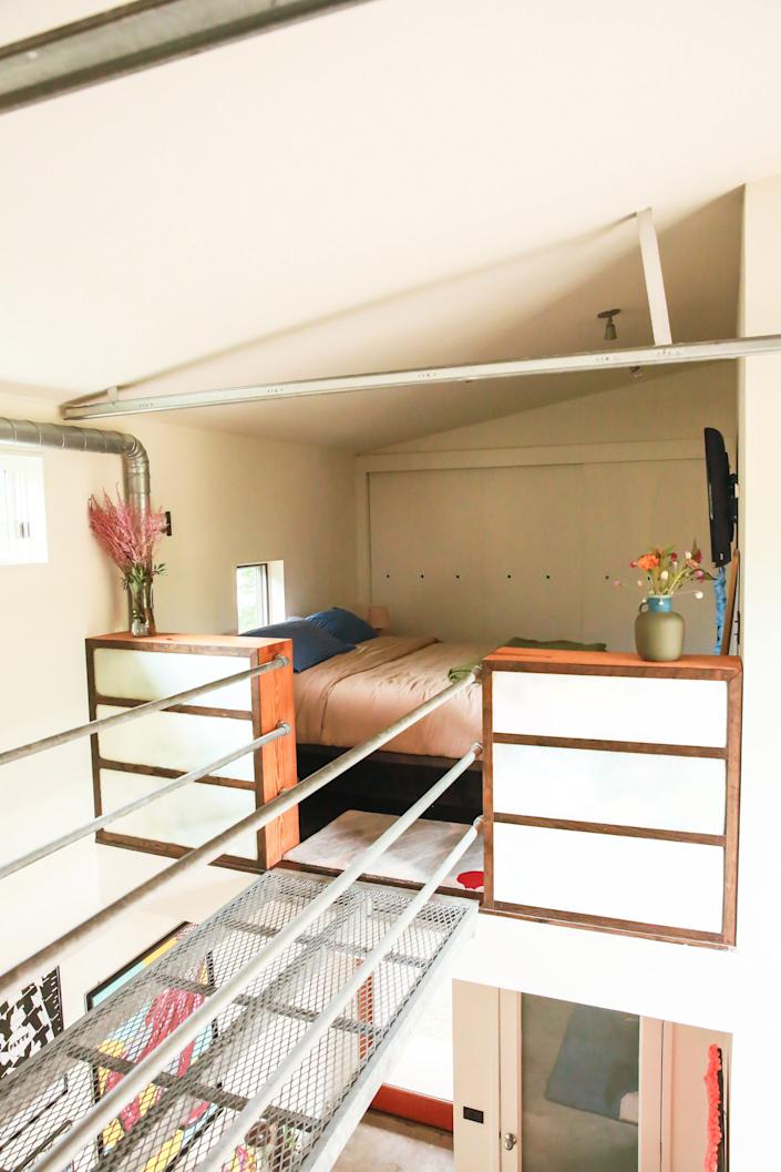 "<div class=""caption""> The lofted bedroom is such a special part of the design of the space. </div>"