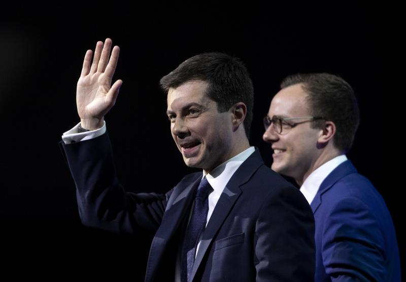Democratic presidential candidate Pete Buttigieg, left, is joined onstage by his husband Chasten Glezman Buttigieg after speaking during the Human Rights Campaign's 14th Annual Las Vegas Gala at Caesars Palace in Las Vegas, Saturday, May 11, 2019. (Steve Marcus/Las Vegas Sun via AP)