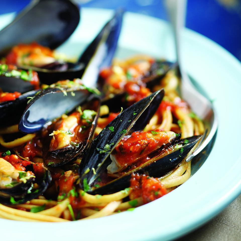 <p>This combination of mussels with plenty of garlic, parsley, saffron and white wine was inspired by the Venetian soup zuppa de peoci, which is usually ladled over sliced crusty bread. Here we serve it over pasta. For a more elegant presentation you can remove the mussels from their shells before serving…but then again, who wants to be elegant? Enjoy!</p>