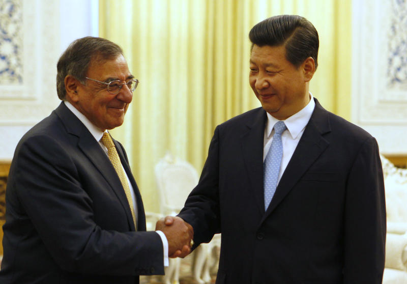 U.S. Defense Secretary Leon Panetta, left, shakes hands with China's Vice President Xi Jinping at the Great Hall of the People in Beijing, China Wednesday, Sept. 19, 2012. Panetta met Wednesday with Chinese leader-in-waiting Xi, who just days ago reappeared after a puzzling two-week disappearance. (AP Photo/Larry Downing, Pool)