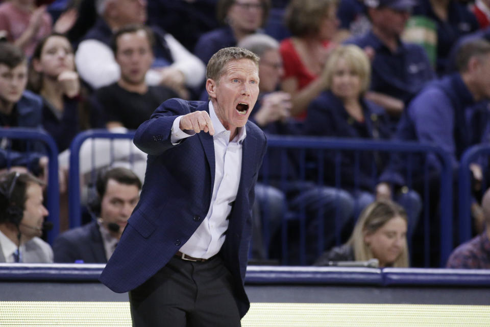 FILE - Gonzaga head coach Mark Few shouts to his players during the first half of an NCAA college basketball game against San Diego in Spokane, Wash., in this Thursday, Feb. 27, 2020, file photo. Gonzaga will begin the college basketball season No. 1 for the first time after coach Mark Few's bunch earned 28 first-place votes in the preseason AP Top 25 poll released Monday, Nov. 9, 2020.(AP Photo/Young Kwak, File)
