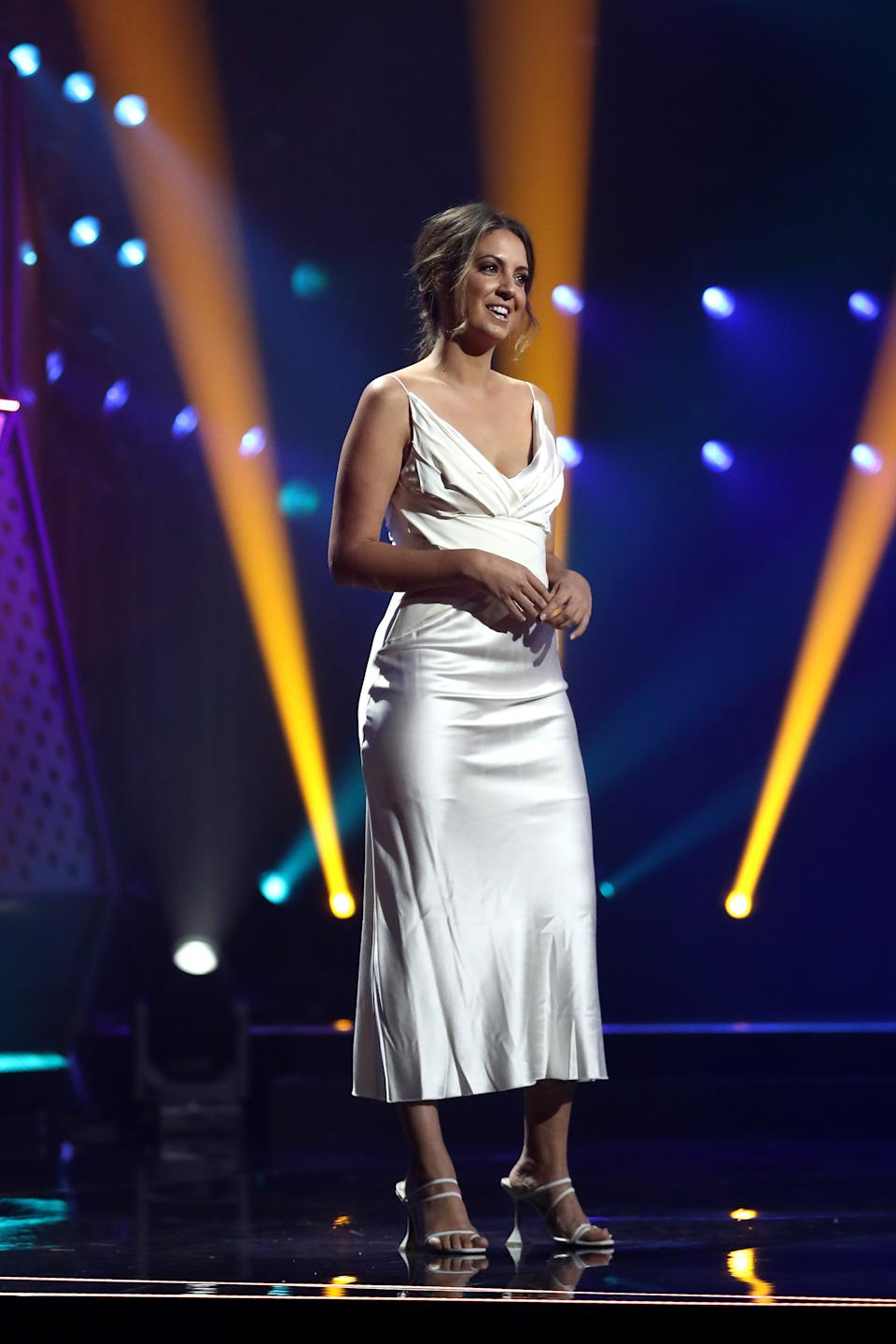 Brooke Boney wears a white slip dress while presenting the ARIA Award for Best Hip Hop Release at the 2020 ARIA Awards at The Star on November 25, 2020 in Sydney, Australia.