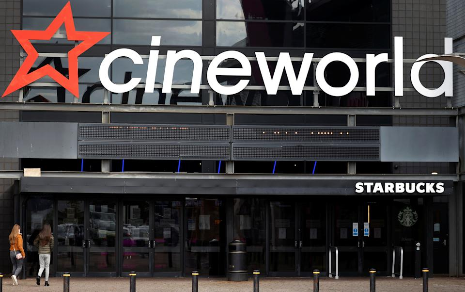 People enter a Cineworld cinema following the outbreak of the coronavirus disease (COVID-19) near Manchester, Britain, October 4, 2020. REUTERS/Phil Noble