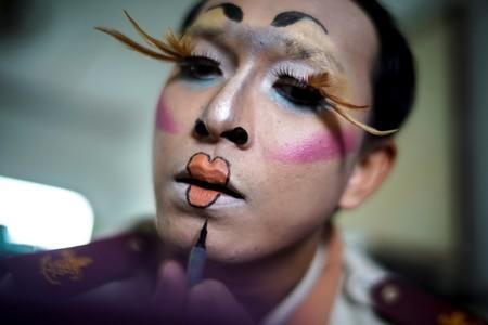 Teeraphong Meesat, 29, known as teacher Bally applies make up before his English class at the Prasartratprachakit School in Ratchaburi Province