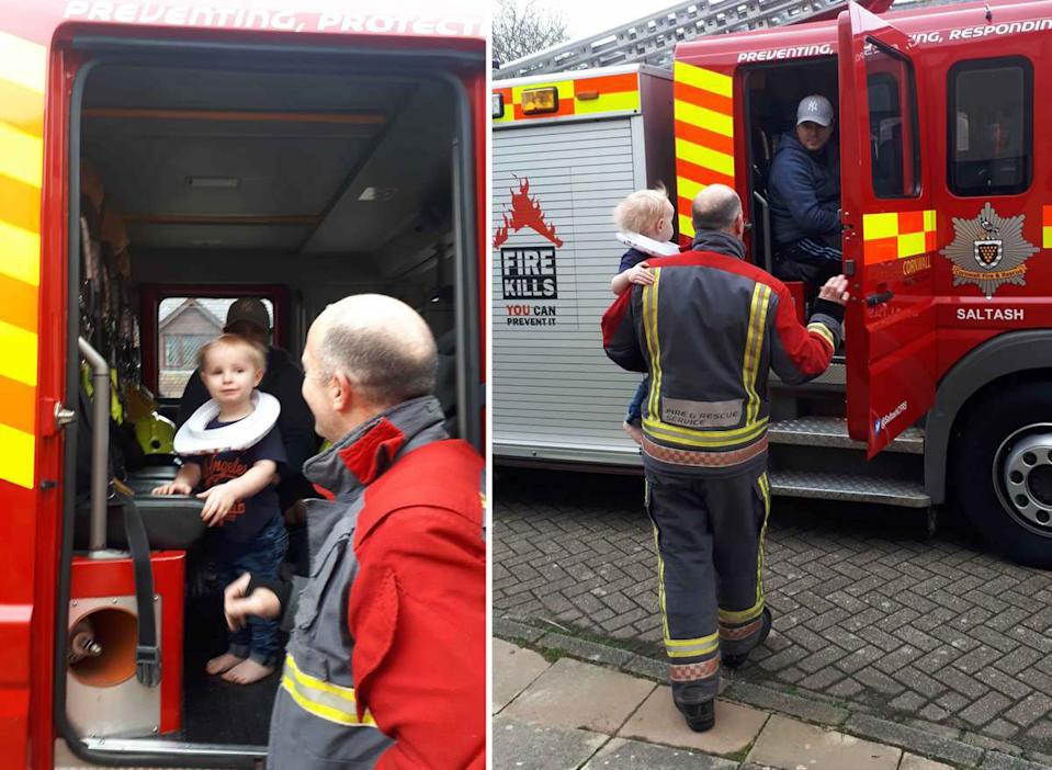 A team of firefighters freed a stuck toddler from a toilet seat (Pictures: Caters)