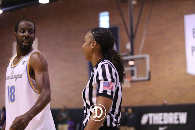 Hogan converses with a player mid-game. (Courtesy of the Drew League)