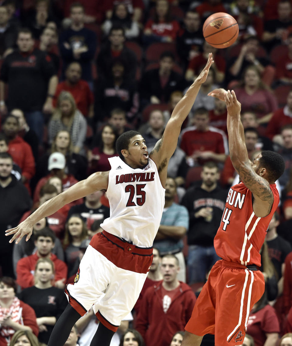 Louisville's Wayne Blackshear, left, attempts to block the shot of Cal State Northridge's Aaron Parks during the second half of an NCAA college basketball game Tuesday Dec. 23, 2014, in Louisville, Ky. Louisville won 80-55. (AP Photo/Timothy D. Easley)