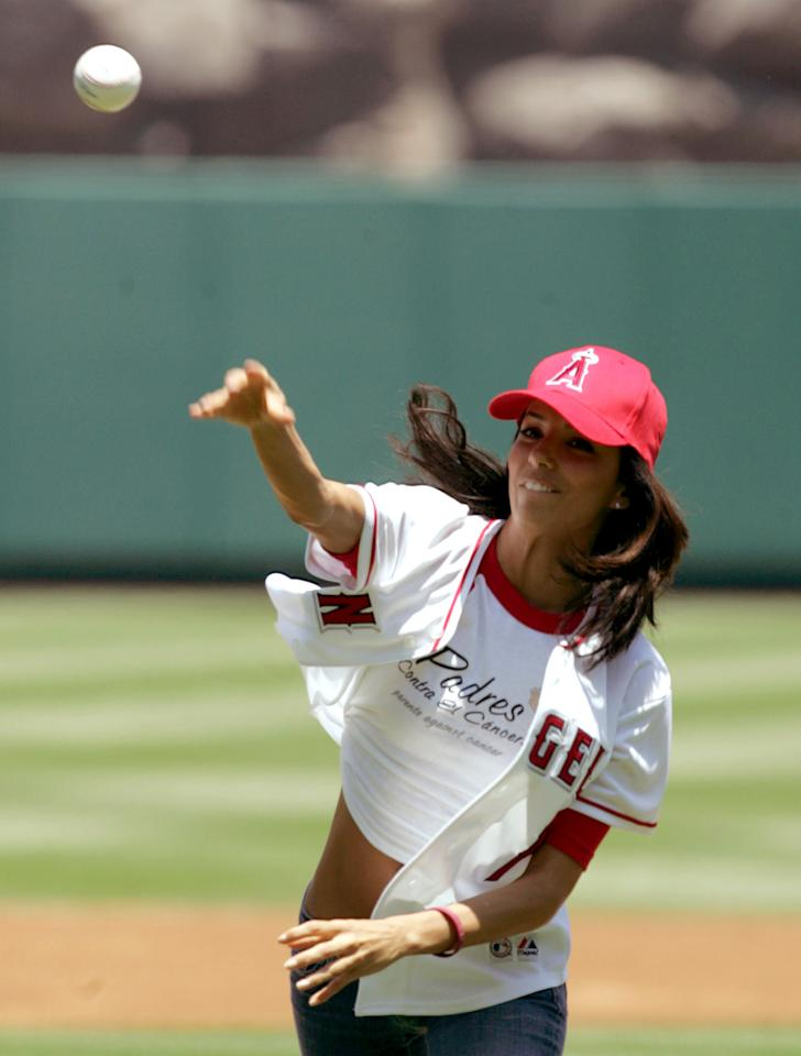 "Eva Longoria throws out the first pitch at the New York Yankees Los Angeles Angels game in Anaheim Calif., on Sunday, July 24, 2005. Longoria is an actress who currently stars in the television show ""Desperate Housewives"". (AP Photo/Chris Carlson)"