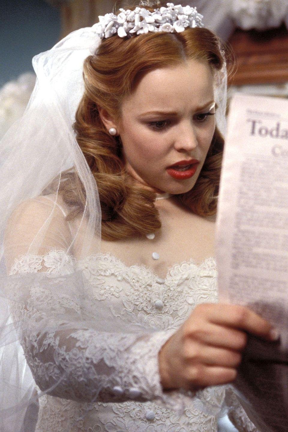 <p>We almost (but not really) wanted to see Rachel McAdams's character, Allie Hamilton, marry Lon so that we could get a better glimpse at the exquisite gown she was planning to wear for the ceremony. The 1940s wedding dress featured front buttons, an illusion neckline, and lots of lace.<br></p>