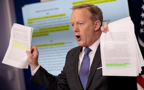 WASHINGTON, DC - JANUARY 30: White House Press Secretary Sean Spicer holds up paperwork highlighting and comparing language about the National Security Council from the Trump administration and previous administrations during the daily press briefing at the White House, January 30, 2017 in Washington, DC. U.S. President Donald Trump announced Monday that he will reveal his 'unbelievably highly respected' pick to replace the late Supreme Court Antonin Scalia on Tuesday evening. (Photo by Drew Angerer/Getty Images) - Credit: DREW ANGERER/2017 GETTY IMAGES