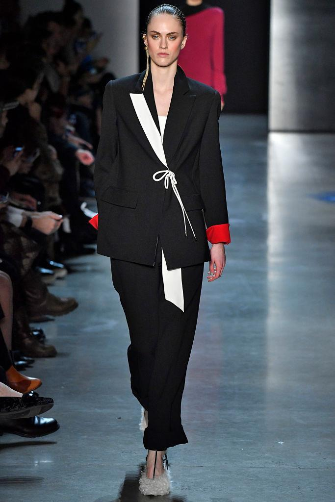 <p>Model wears a black-and-white contrast pansuit at the fall 2018 Prabal Gurung show. (Photo: Getty Images) </p>