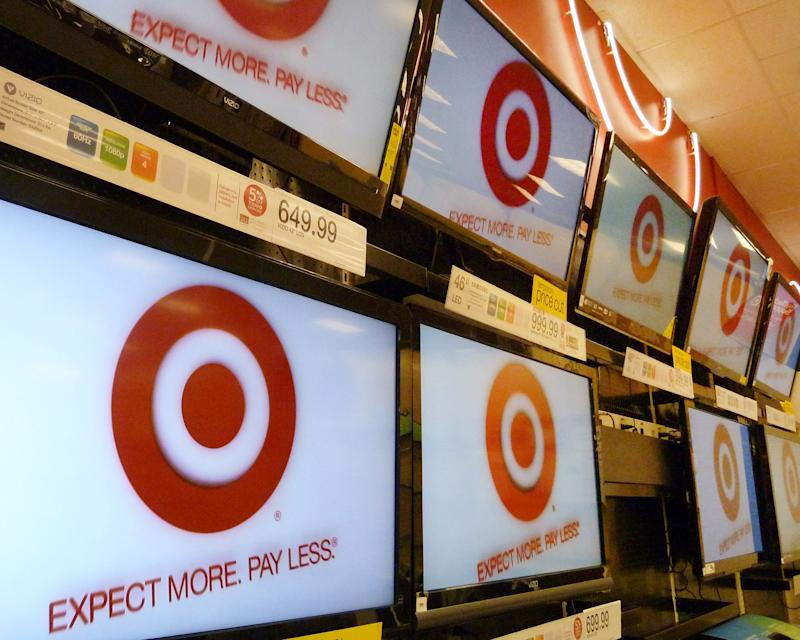 FILE- A Feb. 20, 2012, file photo, shows flat screen televisions at a Target store in Methuen, Mass. Target Corp. is reporting a 1.2 percent increase in first-quarter profit as the discounter pulled in more shoppers for food and trendy fashions. Target's results come as economists are carefully dissecting consumer spending trends amid growing economic uncertainty. Like many retailers, Target saw that business in April 2012 was disappointing as warmer-than-usual weather earlier in February and March and an early Easter pulled sales forward.   (AP Photo/Elise Amendola, File)