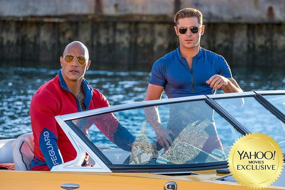 """<p>Does the world really need a <em>Baywatch</em> movie? Probably not, but we're not crazy enough to tell superstar muscleman <a rel=""""nofollow"""" href=""""https://www.yahoo.com/movies/tagged/dwayne-johnson"""" data-ylk=""""slk:Dwayne Johnson"""" class=""""link rapid-noclick-resp"""">Dwayne Johnson</a> that. Besides, his promise that the movie will be """"<a rel=""""nofollow"""" href=""""https://www.yahoo.com/movies/baywatch-movie-far-dirtier-tv-show-dwayne-johnson-181814669.html?soc_src=mail&soc_trk=ma"""" data-ylk=""""slk:far dirtier;outcm:mb_qualified_link;_E:mb_qualified_link;ct:story;"""" class=""""link rapid-noclick-resp yahoo-link"""">far dirtier</a>"""" than the series, combined with <a rel=""""nofollow"""" href=""""https://www.yahoo.com/movies/baywatch-trailer-dwayne-johnson-vs-drug-dealers-zac-efron-and-an-ocean-on-fire-181811067.html?soc_src=mail&soc_trk=ma"""" data-ylk=""""slk:funny early trailers;outcm:mb_qualified_link;_E:mb_qualified_link;ct:story;"""" class=""""link rapid-noclick-resp yahoo-link"""">funny early trailers</a>, has us genuinely psyched to hit the beach … in superslow-mo, natch. (Photo: Paramount Pictures) </p>"""