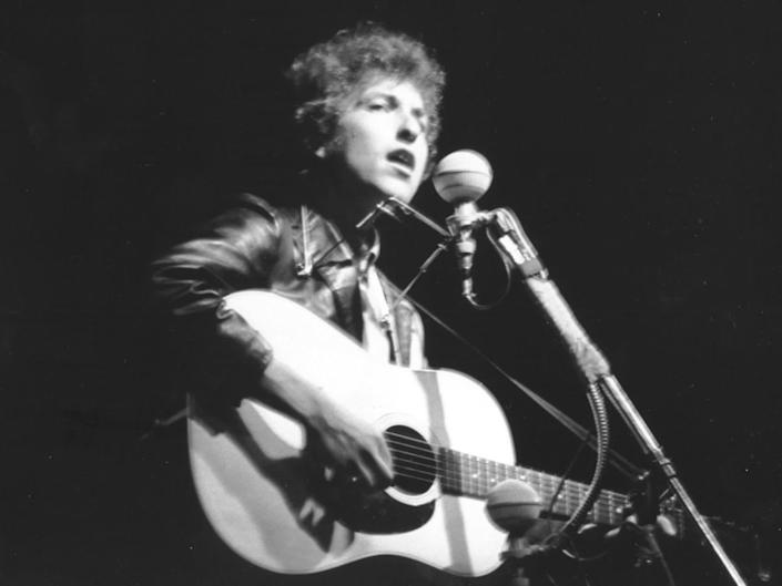 Bob Dylan performs at Rhode Island's Newport Folk Festival in July 1965: Getty
