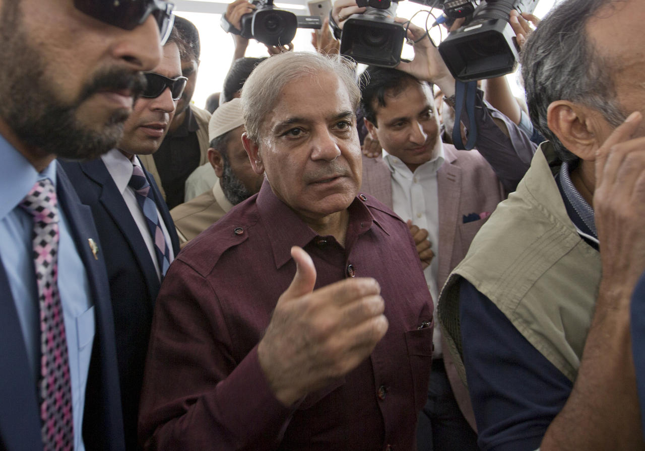 Pakistani opposition leader Shahbaz Sharif, center, who lost election for the premiership of Pakistan, arrives at the National Assembly in Islamabad, Pakistan, Friday, Aug. 17, 2018. Pakistani lawmakers on Friday elected former cricket star and longtime politician Imran Khan as the country's next prime minister in a step toward third straight transfer of power from one civilian government to another one. (AP Photo/B.K. Bangash)