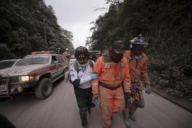 <p>Firefighters leave the evacuation area near Volcan de Fuego, or Volcano of Fire, in El Rodeo, Guatemala, June 3, 2018. (Photo: Santiago Billy/AP) </p>